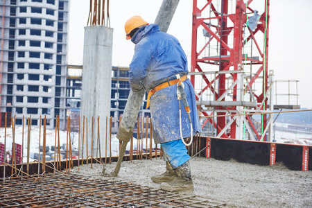 erector: construction site worker at concrete works at building area Stock Photo