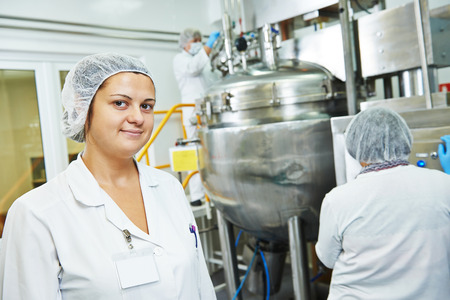 factory line: portrait of female pharmaceutical factory worker in pharmacy industry manufacture factory