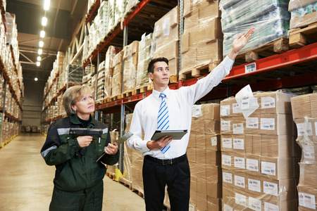 warehousing: manager and worker in warehouse with bar code scanner Stock Photo
