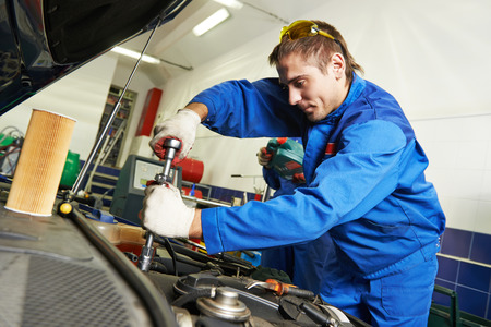 scheduled replacement: auto repairman industry mechanic worker in car auto repair or maintenance shop service station
