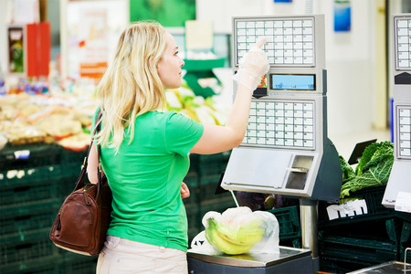 weighting: Shopping. Woman weighting banana fruits bio food in vegetable store or supermarket