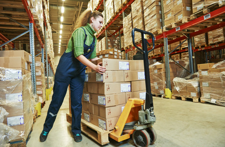 storage warehouse: worker in warehouse with bar code scanner