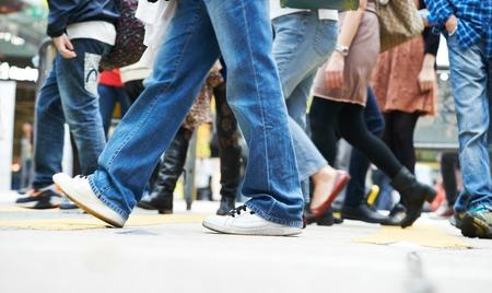 crowd: Pedestrians crossing a street. Urban rush hour