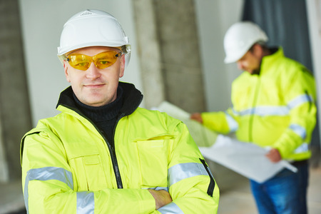 project property: young male construction engeneer worker project manager at a indoors building site