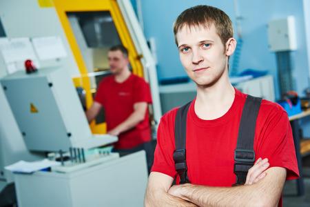 maintenance fitter: manufacture technician worker at factory metal machining shop