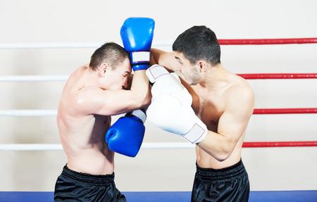 thai arts: combat sport muai thai sportsman fighting at training boxing ring