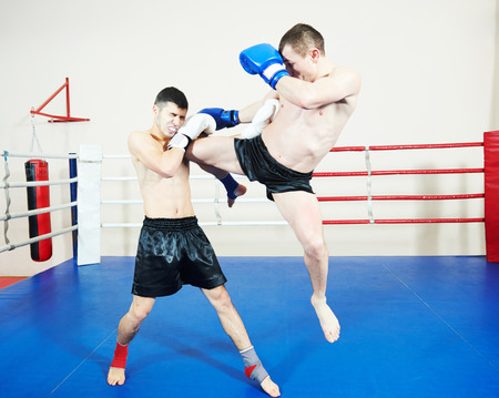 phisical: combat sport muai thai sportsman fighting at training boxing ring