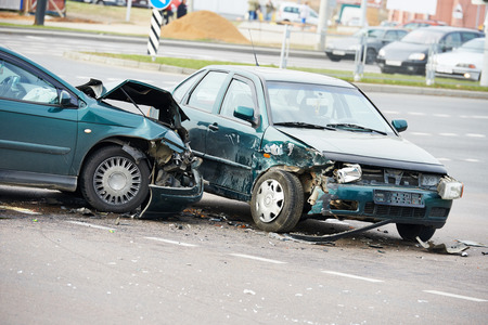 road incident car crash on a street, damaged automobiles after collision in city