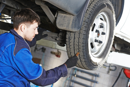 protector: auto service man worker measuring rubber car wheel tyre protector