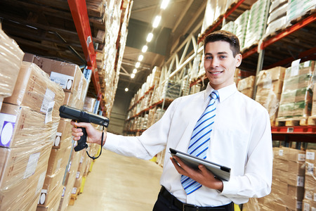 bar code scanner: manager worker in warehouse with bar code scanner