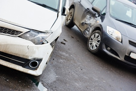 car crash accident on street, damaged automobiles after collision in city Foto de archivo
