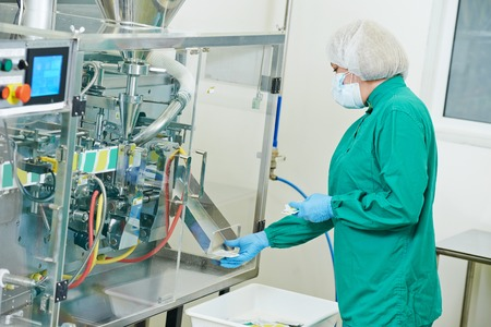 pharmaceutical factory woman worker operating production line at pharmacy industry manufacture factory Stock fotó