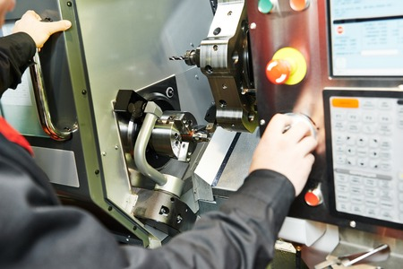 drilling hole or boring detail on metal cutting machine tool at manufacturing factory Stock Photo