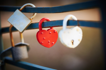 faithfulness: Red and White Love Lock as a symbol of relationship faithfulness Stock Photo