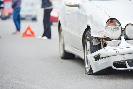 crash accident on street. damaged car automobile after collision in city Stock Photo