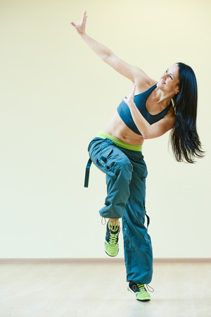 zumba: female zumba instructor doing dancing exercises in sport club Stock Photo