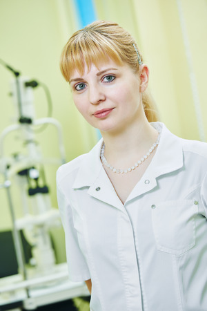 correction: Ophthalmology. portrait of female optometrist optician doctor in eye correction medic clinic Stock Photo