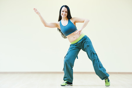 zumba: zumba firness instructor doing dancing exercises in sport club Stock Photo