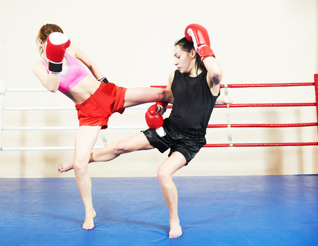 phisical: muai thai women fighting at training boxing ring
