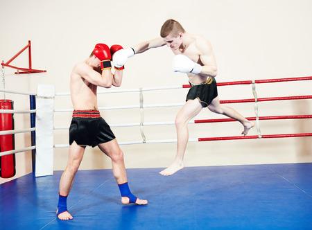 elbow pads: muai thai sportsman fighting at training boxing ring