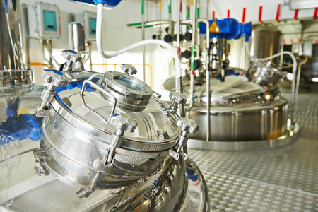 factory line: factory with pharmaceutical equipment mixing tank on production line in pharmacy industry manufacture factory