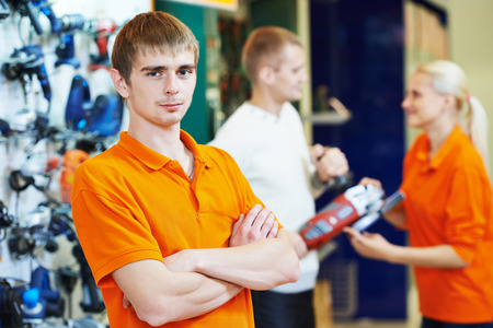 retailer: shop assistant seller in supermarket store