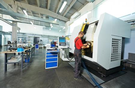 manufacture technician worker at factory metal machining shop photo