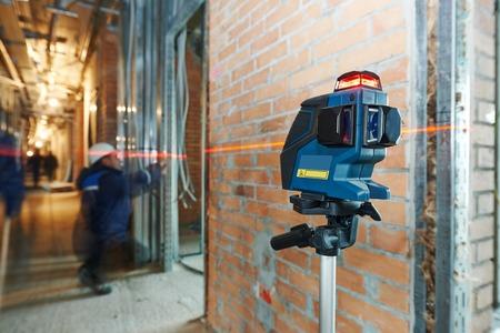 laser level equipment in measurement work at indoor construction site photo