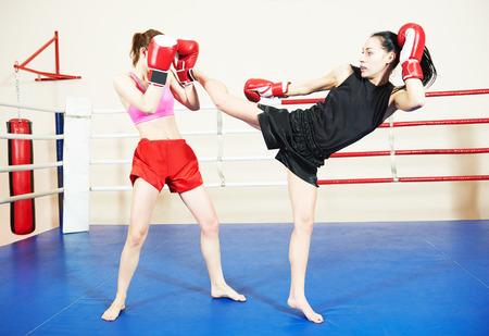 women fighting: muai thai women fighting at training boxing ring