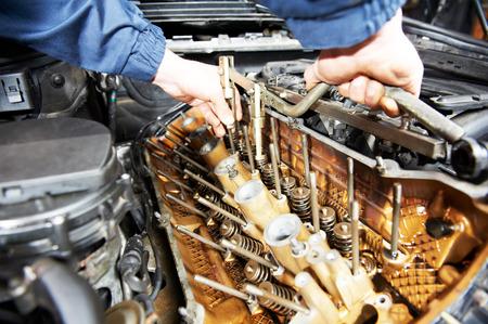 job engine: mechanic repairman at automobile car engine maintenance repair work Stock Photo
