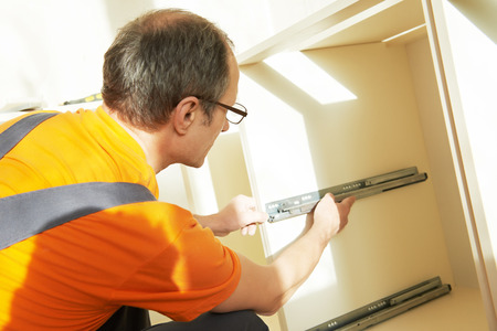 marking up: Craftsman kitchen carpenter at kitchen cabinet installation service work
