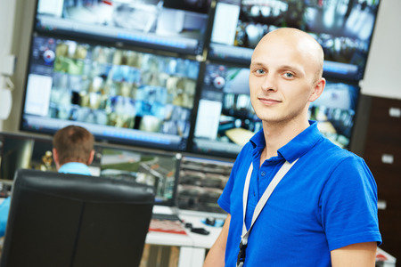 monitoring system: Portrait of security guard over video monitoring surveillance security system