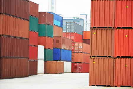 intermodal: Stack of freight container boxes after sorting in warehouse dock terminal of cargo sea port Stock Photo