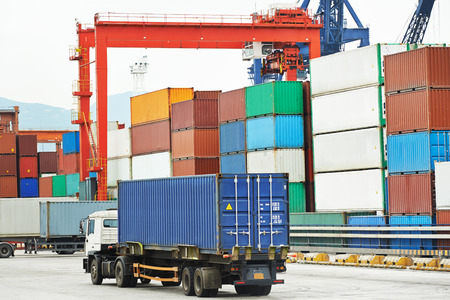 intermodal: dock terminal of freight container boxes in open air cargo sea port warehouse Stock Photo