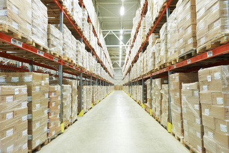 packaging industry: interior of warehouse. Rows of shelves with boxes