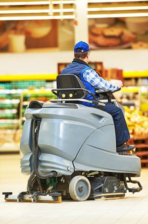 cleaning service: Floor care and cleaning services with washing machine in supermarket shop store