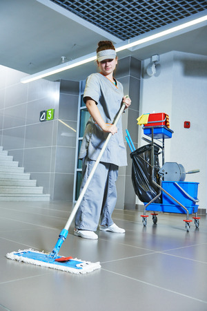 service industry: Floor care and cleaning services with washing machine in supermarket shop store