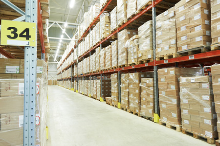 warehouse storage: interior of modern warehouse. Rows of shelves with boxes Stock Photo