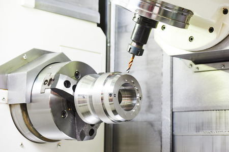 metalworking industry: drilling a hole on modern metal working machining center Stok Fotoğraf