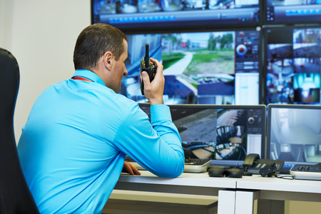 security guard watching video monitoring surveillance security system Standard-Bild