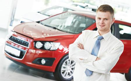 automobile dealer: Portrait og salesperson or manager of car automobile dealer welcoming with open arms