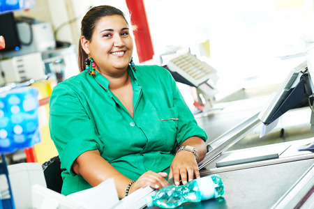 supermarket checkout: Portrait of seller assistant or cashdesk cashier worker teller in supermarket store Stock Photo