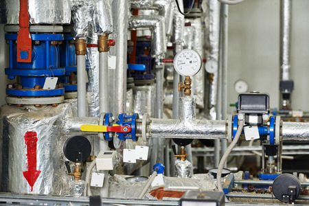 circulation: manometers, pipes and faucet valves of gas heating or water circulation system in a boiler room Stock Photo