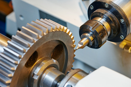precision: metal working. Process of tooth gear wheel finish machining by cutter tool at factory