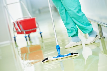 mopping: Floor care and cleaning services with washing mop in sterile factory or clean hospital