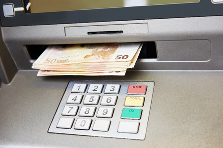 withdrawal: Cash withdrawal. Euro banknotes in ATM Stock Photo