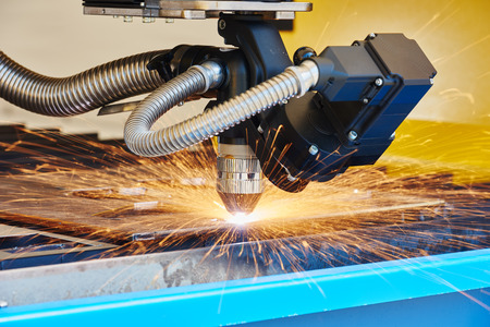 cut: metal working. Plasma or Laser cutting technology of flat sheet metal steel material with sparks Stock Photo