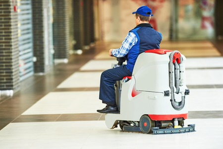 clean floor: Floor care and cleaning services with washing machine in supermarket shop store