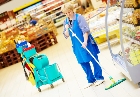 wet men: Floor care and cleaning services with mop in supermarket shop store