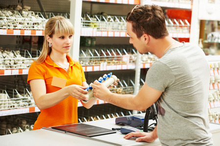 hardware: Young woman help purchaser choosing plumber equipment in hardware shopping mall supermarket